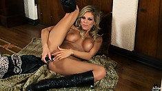 Big-tittied blonde in knee-high boots stuffs her gash with a toy