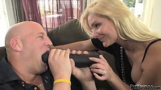 Blonde gears up with a strap on and fucks her man like a bitch