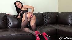 Gorgeous milf Mahina Zaltana displays her huge tits and big round ass on the sofa