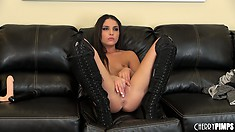 Giselle Leon rubs her young pussy while posing in knee high boots