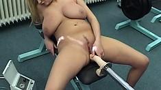 Titana combines machine fucking with vacuum stimulation for her gigantic tits