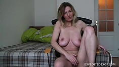 Voluptuous blonde milf Vanessa displays her big boobs and fingers her shaved peach