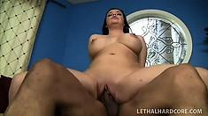 Buxom Emma Heart uses her mouth and then gets drilled by a black cock
