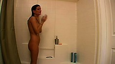 Kat turns on her webcam to put on a shower show for her fans