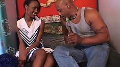 Wild ebony cheerleader has her horny black neighbor fucking her tight pussy deep