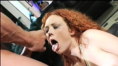 Alluring redhead with sexy tits sucks a big dick and gets her holes banged hard