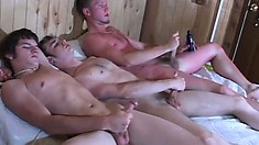 A little outside action, then bed action, and these three gays jack off together