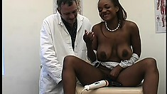 Horny black babe with a nice rack gets some help from her doctor