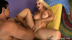 Mandy Sweet, a busty blonde with a superb ass, takes a long cock deep in her twat