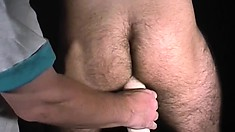 Blindfolded stud has a guy fingering his butt and stroking his dick