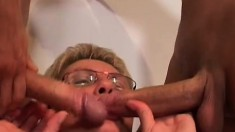 Short haired blonde granny getting nailed by two young guys on the bed
