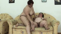 Two big lesbians with a midget and a huge lady munching on some pussy