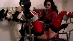 Gorgeous lesbians with a latex fetish punish a kinky slave girl