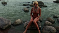 Striking blonde Masha loves being watched while walking naked on the beach