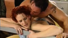 Alluring redhead in black stockings Inna fully enjoys a rough drilling