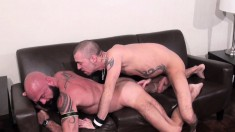 Muscled hunk sucks a big prick and takes it in his ass doggy style
