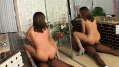 Sultry Jennifer goes crazy for a long black stick in front of a mirror