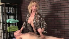 Naughty blonde masseuse exposes her big boobs and milks a long prick