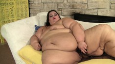 Fat lady lies on the couch and makes herself cum hard with sex toys
