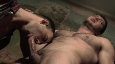 Muscled hunk has a naughty guy blowing his large stick in the shower