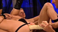 Bound stud endures melted candle wax and rough anal sex in an all-male gangbang