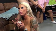 Tattooed blonde with huge boobs gets pumped full of cock on the couch