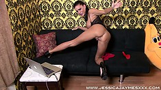 She poses and spreads her cheeks before sitting and toying her cunt