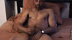 Black dude with a two-hand size cock jerks it off at home alone