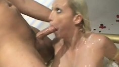 Blonde whore with big tits takes a long cock up her ass in the bathtub