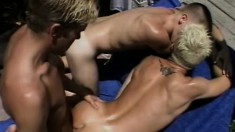 These horny twinks get a tan while fucking each other outdoors