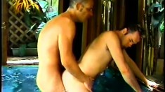 Dirty dudes in a jacuzzi suck each other's long throbbing poles