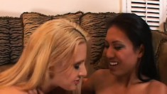 Busty blonde girl and slim Asian babe enjoy lesbian sex on the couch