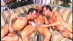 An amateur threesome featuring some horny hunks sucking and fucking