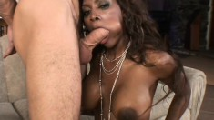 Wonderful black babe with heavenly tits and ass fucks a big white cock
