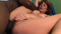 A sexy redhead MILF begs for more from this stiff black pole