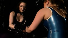 Dirty BDSM slut is completely encased in latex and played with