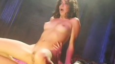 Attractive brunette sticks a cock in her ass and fucks it with passion