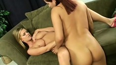 A fresh redhead gets her lesbian initiation from a horny blonde