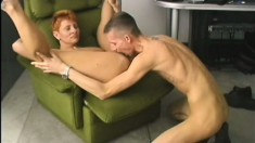 Short haired redhead milf has a young stud taking care of her desires