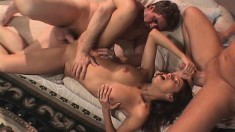 Gorgeous brunette wife gets drilled by two studs in front of her man