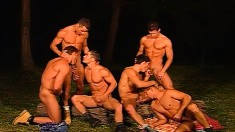 Six muscled and horny gay boys getting down and dirty in the outdoors