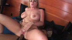 Stacked Daphne Rosen rubs her clit while a black pole invades her ass