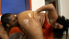 Insatiable ebony plumper oils up her big booty and enjoys a black dick