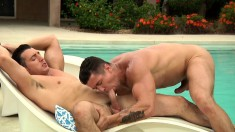 Exciting hunk gives his gay partner a deep anal drilling by the pool