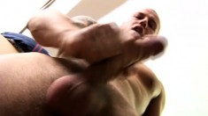 Tattooed hunk with a worked out body drives his long shaft to orgasm