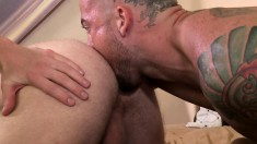 Young blonde has his tight asshole stretched by a tattooed stud