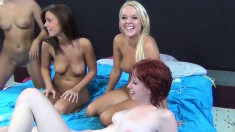 Five insatiable girls have fun with sex toys and hard cocks on the bed