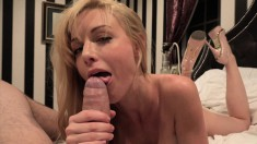 Hot busty blonde chews on a big stiffy and gets a load on her face