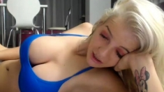 Busty blonde playing with their boobs